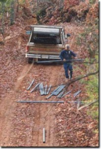 We ran our utilities underground.  This was the first trip up the hill with building supplies and one by one all the pipe slide out the back of the pickup!  This was also the first picture of about a 1000 I took while building.